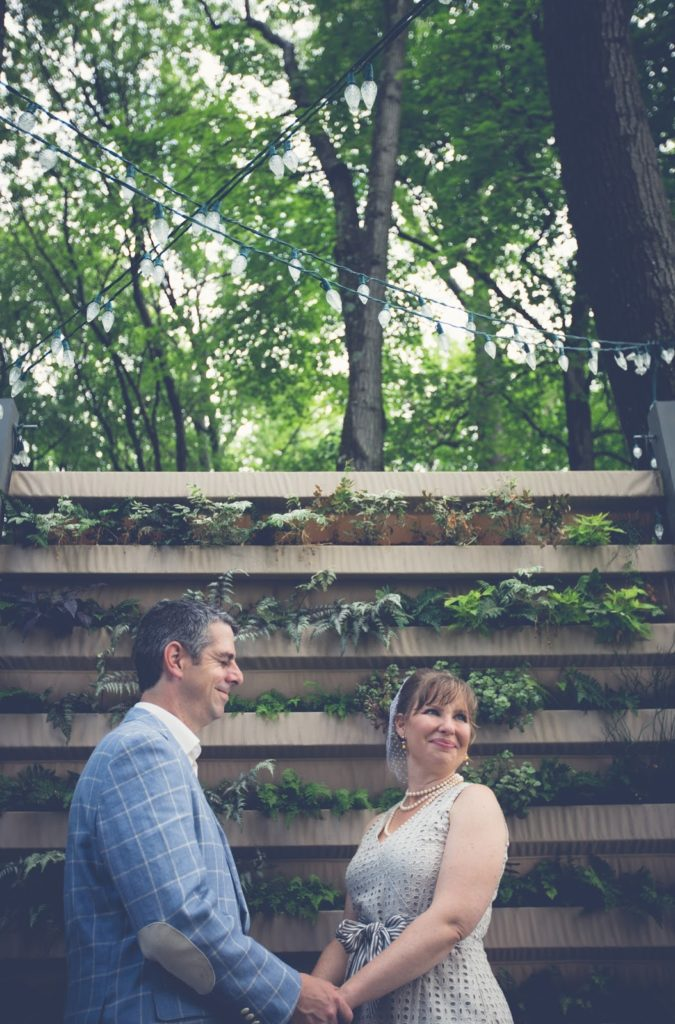 Heather and Nathan hold hands Alisa Tongg Celebrant Family Vow Renewal at The Living Wall at Promise Ridge Jeremie Barlow Photography