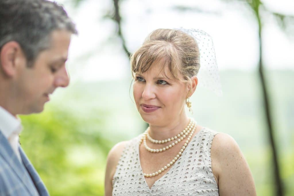 Nate vows Alisa Tongg Celebrant Family Vow Renewal at The Living Wall at Promise Ridge Jeremie Barlow Photography