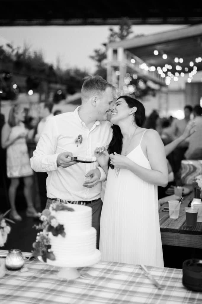 black and white wedding cake swirly kiss alisa tongg celebrant race street peir philadelphia wedding emily wren photography