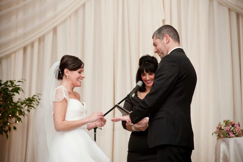branden checks out his wedding ring vie wedding alisa tongg celebrant heather fowler photography