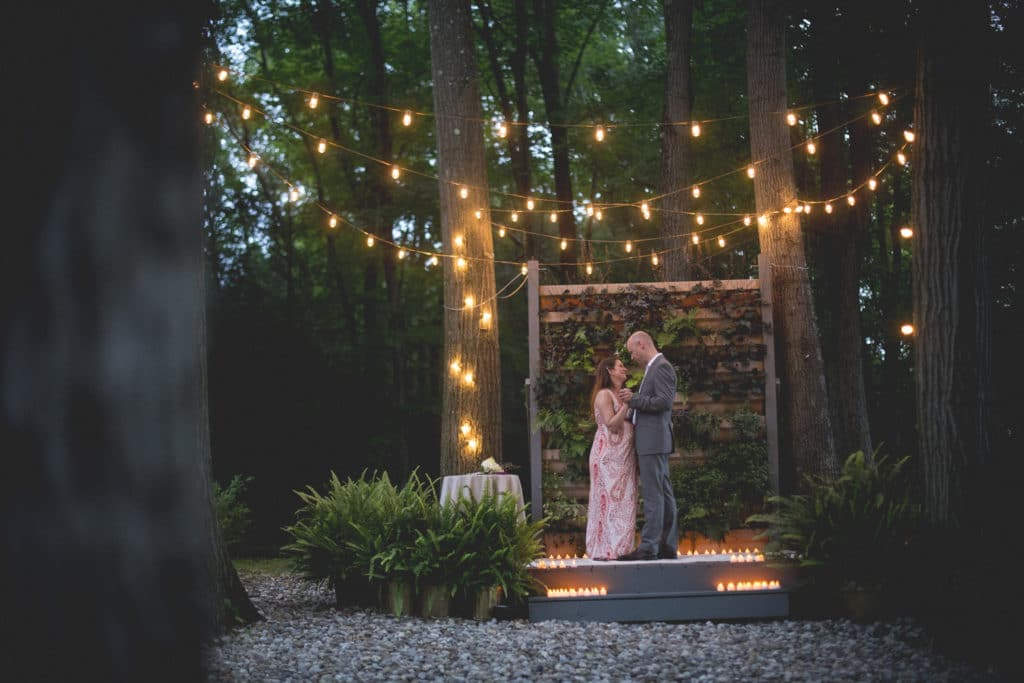 candle lit first dance intimate Blue Hour Elopement at The Living wall at Promise Ridge Rob Yaskovic Photography
