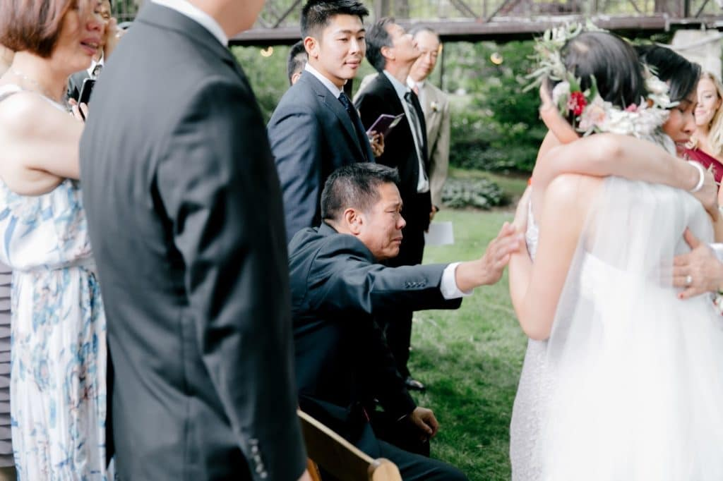 father reaches for bride at hand off alisa tongg celebrant emily wren photography