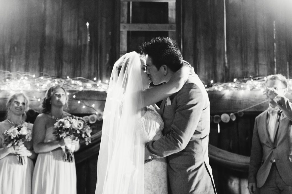 first kiss black and white alisa tongg celebrant with love and embers photography