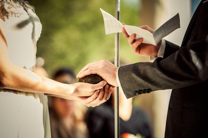 groom sets his promises into stone. oathing stone. alisa tongg celebrant. bill cardoni copy 2