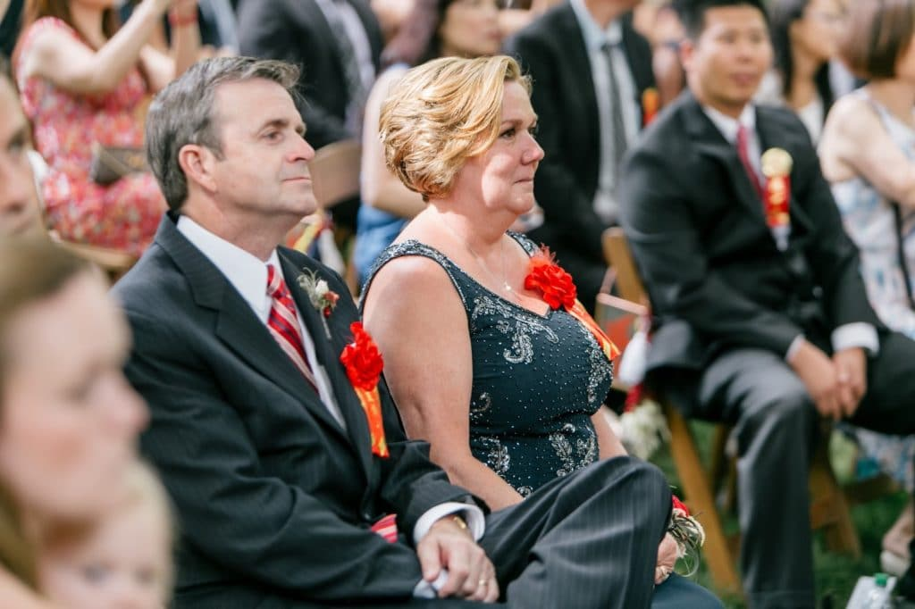 grooms parents adorned with red garlands for chinese tea ceremony alisa tongg celebrant emily wren photography
