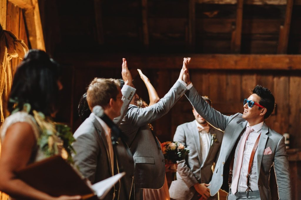 jeremy high fives to the altar alisa tongg celebrant with love and embers photography
