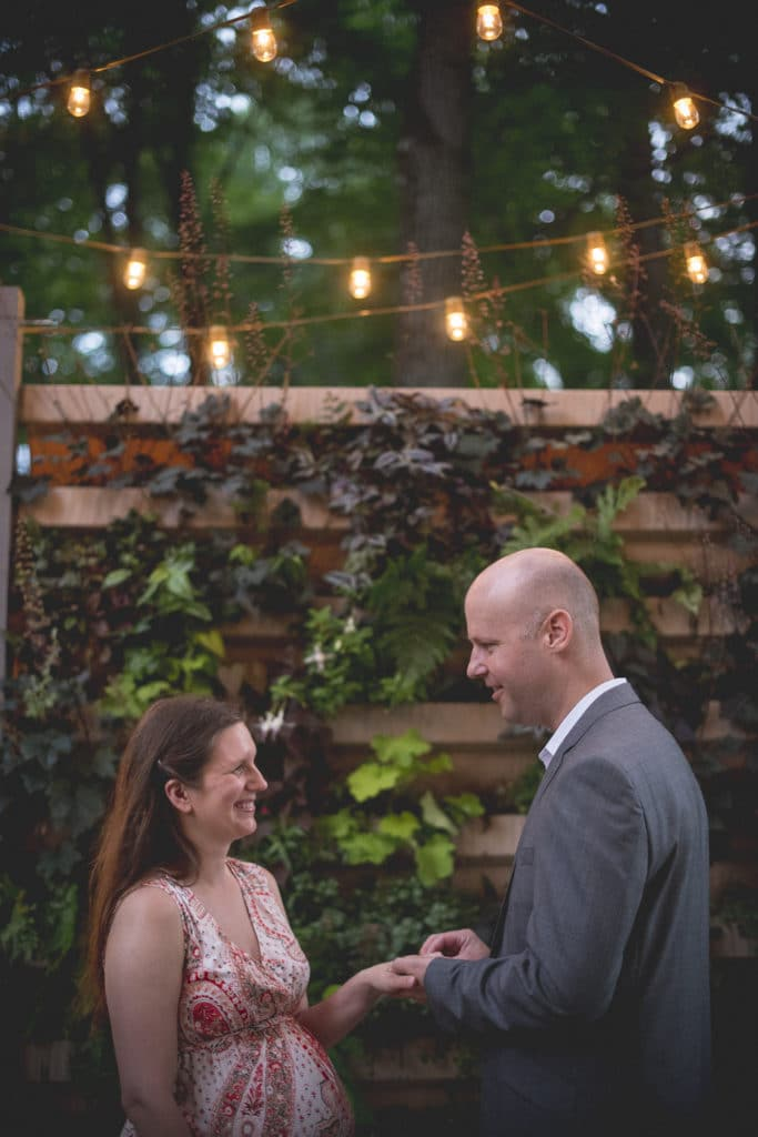 ring exchange Blue Hour Elopement at The Living wall at Promise Ridge Rob Yaskovic Photography
