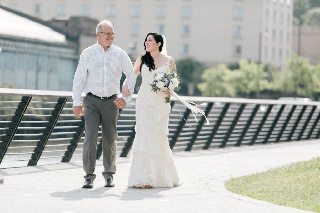 tiffany walks in with her father alisa tongg celebrant race street peir philadelphia wedding emily wren photography