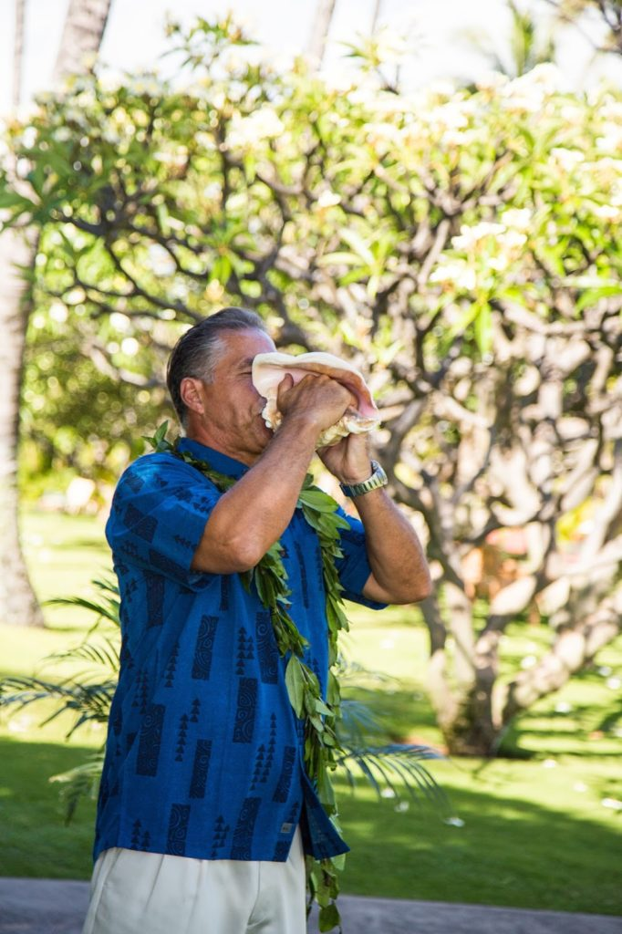 uncle michael blowing the conch alisa tongg celebrant chelsea heller photography